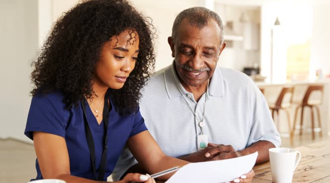 caregiver assisting senior man about his appointments