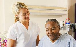 caregiver looking at senior man