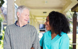 caregiver and senior man looking at each other