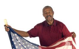 senior man raising flag