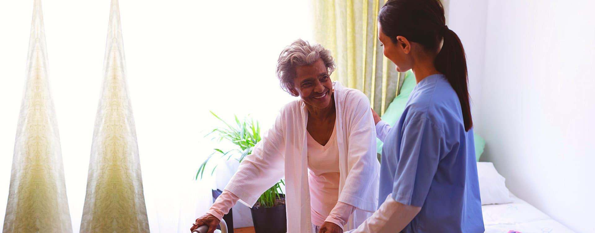 happy senior woman looking at caregiver